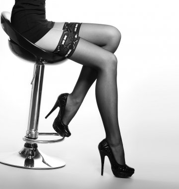 Beautiful legs in nice stockings over white background