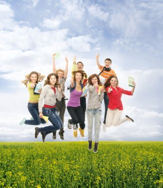 Group of smiling teenagers jumping together