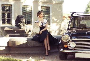 Young and sexy woman with her car