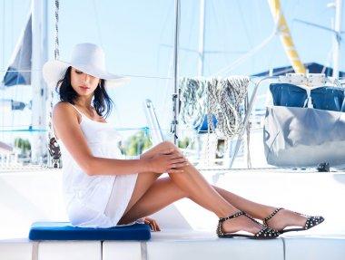 Beautiful woman on luxury yacht