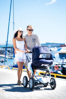 Couple walking with baby pram