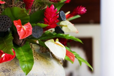 Flower decor with anthurium and lotus seeds