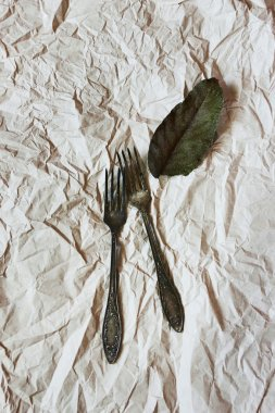 Vintage cutlery on a paper background