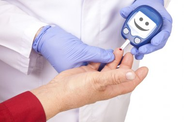 Doctor making blood sugar test. Smiley face
