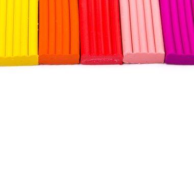 Colorful kid's plasticine on white background, Colorful dough mo