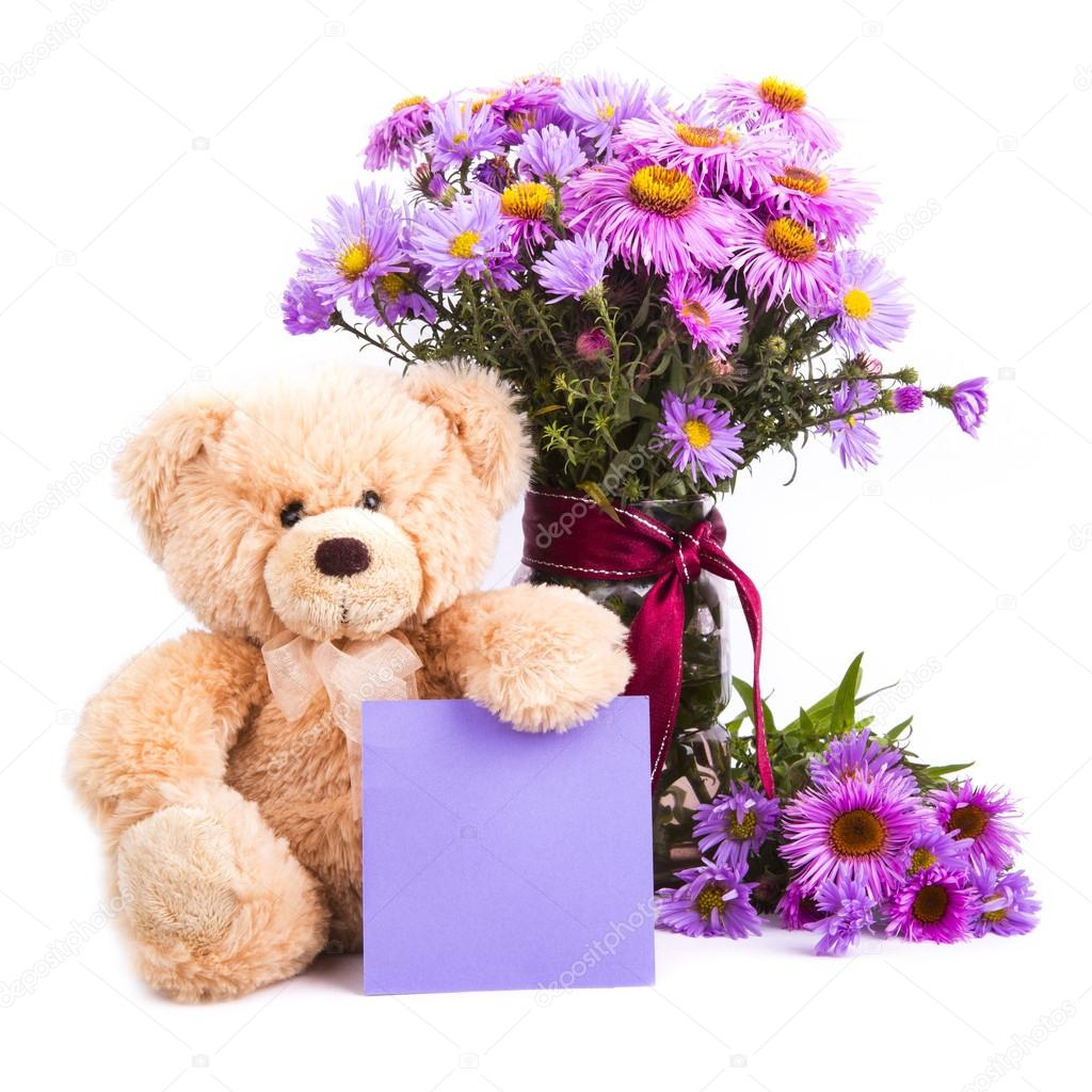 ursinho de pelúcia e flores — Fotografias de Stock © lamento  35202595 864a25f305ba2