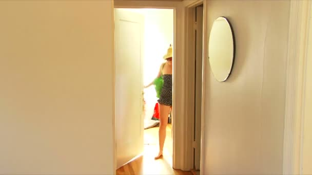 Man and woman couple in hallway of house walk out from rooms