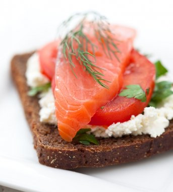 Red fish canape with cream cheese and tomato