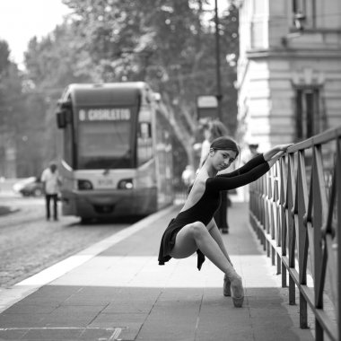 Young beautiful ballerina dancing out in the street in Rome, Italy. Black and white image. Ballerina Project.