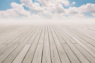 Cloudy blue sky and wood floor, background image.