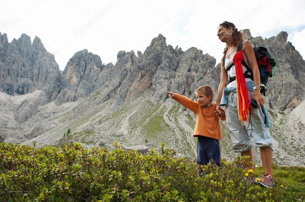 Mother and son walking in Dolomites, Italy.