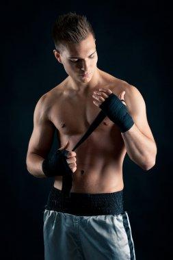 Sportsman boxer portrait against black background