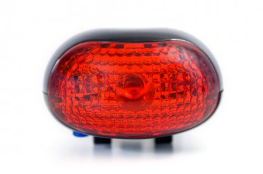 Red bicycle rear lamp on white background. Front view