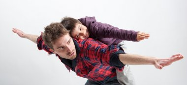 Young father and son playing together portrait. Studio shot