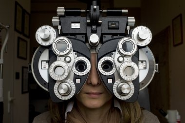 Optometrist diopter with girl