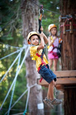 6 year old kids climbing trees in Dolomites, Italy
