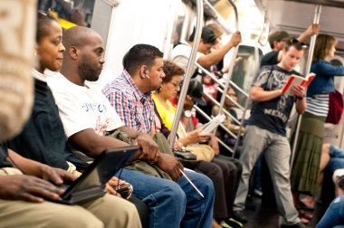 NEW YORK CITY - JUNE 27: Commuters in subway wagon