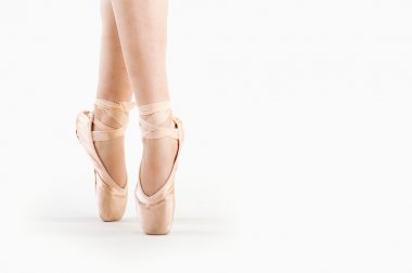 Feet close up of dancer isolated on white background