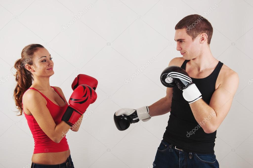 Sporty couple fighting with boxing gloves