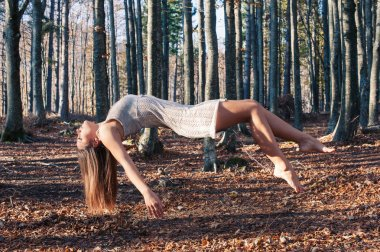 Levitation portrait of young woman in the woods