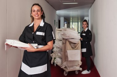 Two chambermaid women cleaning in a hotel