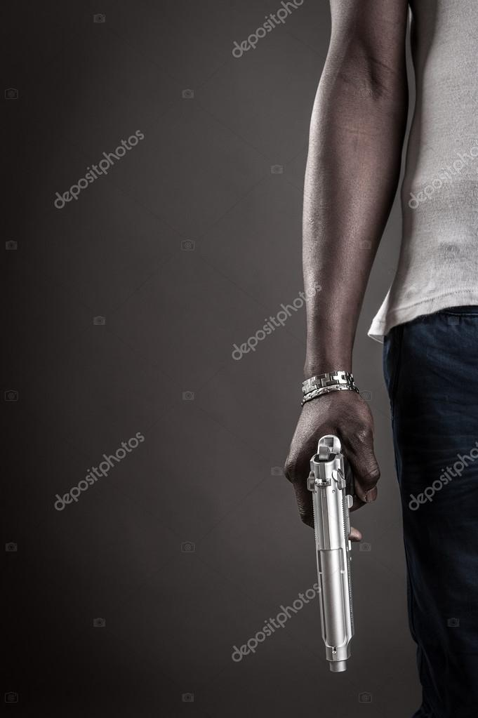 Killer with gun close up over dark background with copyspace. stock vector