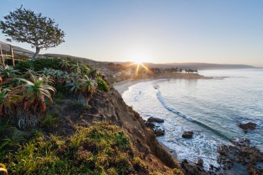 This is an image of a sunrise over Crescent Bay, Laguna Beach, CA taken from Crescent Bay Point Park. stock vector