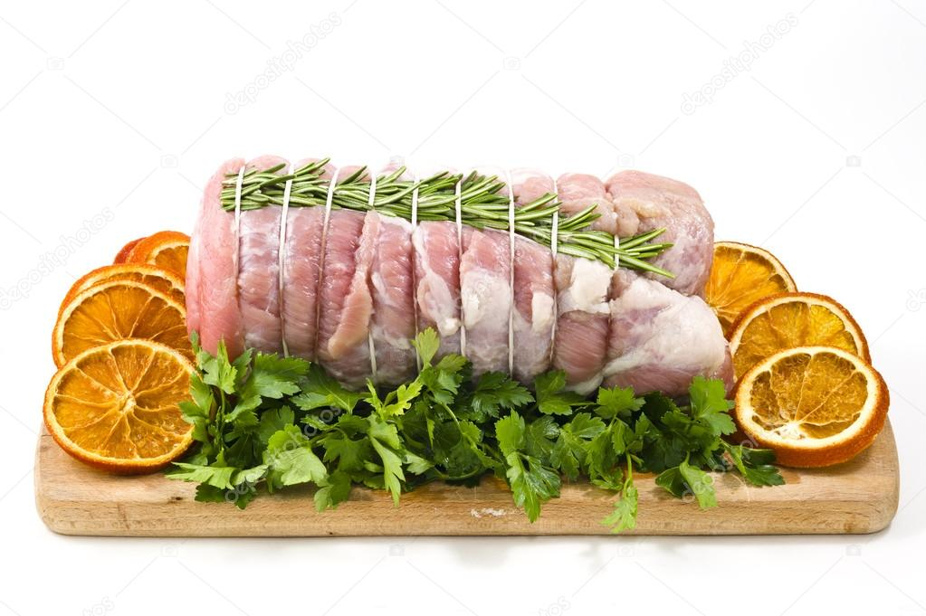 Roast of veal with rosemary and orange slices