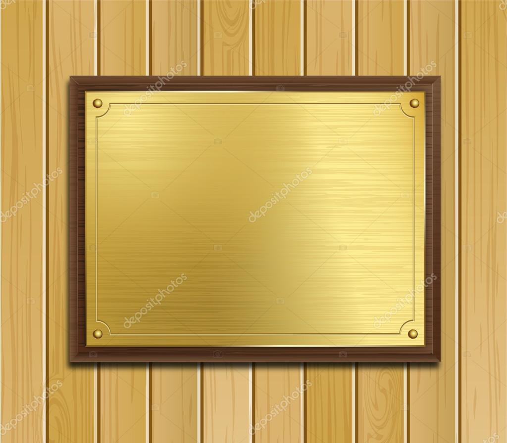 Brass Plaque On a Wood Panel Background