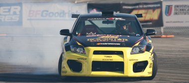 Tanner Foust competes at Toyota Speedway during Formula Drift round