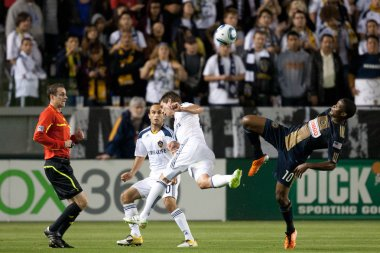 Danny Mwanga, Todd Dunivant and Landon Donovan in action during the game between the Philadelphia Union and the Los Angeles Galaxy at the Home Depot Center