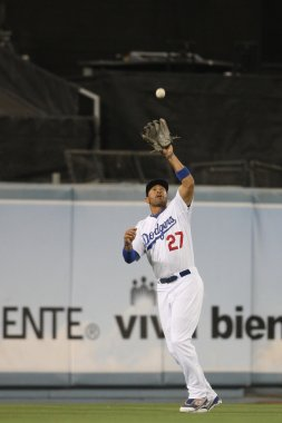 MATT KEMP catches a fly ball during the game