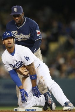 MATT KEMP slides into to second to complete a double while MIGUEL TEJADA tries to make the tag during the game