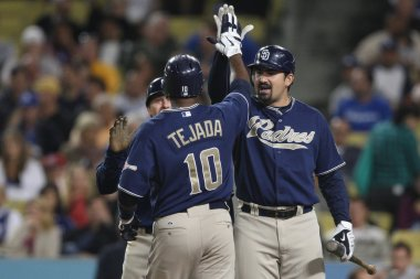 MIGUEL TEJADA and ADRIAN GONZALEZ celebrate scoring with a high five during the game