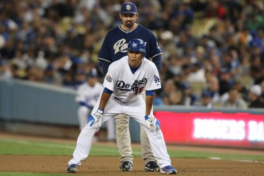 HIROKI KURODA leads off from first with ADRIAN GONZALEZ behind him during the game