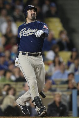 ADRIAN GONZALEZ watches as he pops up during the game