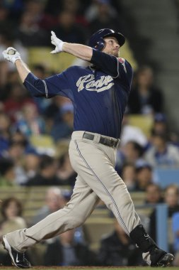 CHASE HEADLEY takes a swing during the game