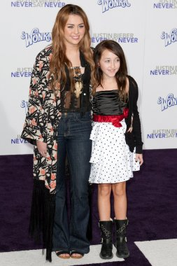 MILEY CYRUS and NOAH CYRUS arrive at the Paramount Pictures Justin Bieber: Never Say Never premiere