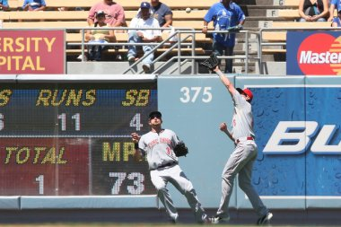 DREW STUBBS catches a deep flyball while JONNY GOMES looks on during the game
