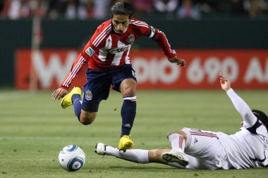 Mariano Trujillo gets past Fabian Espindola during the game