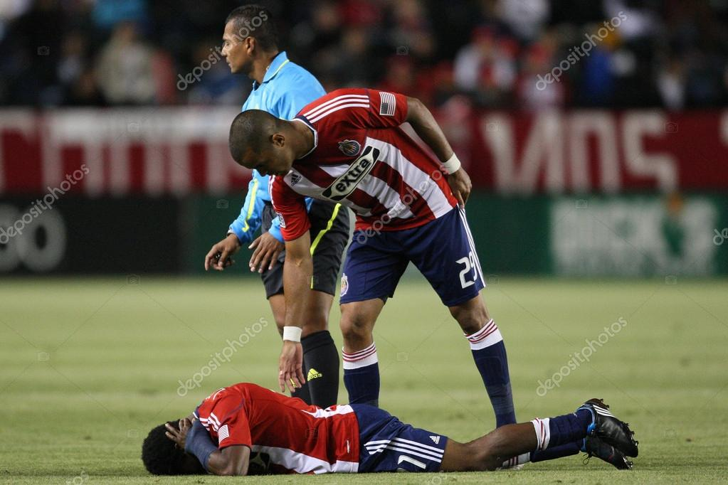 Maicon Santos checks on Michael Lahoud after he took a hit to head during the game