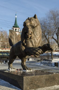 Bronze figure of a mythical beast babr, carrying the sable in his mouth. The Personage of the Coat of Arms of Irkutsk