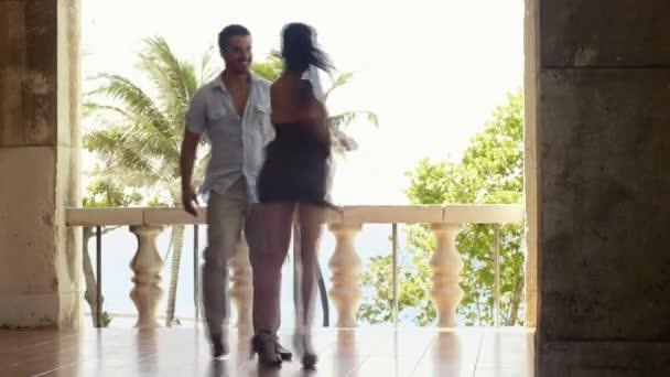 young hispanic couple dancing latin american dance outdoors