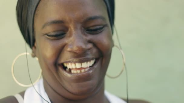 portrait of happy black adult woman laughing for joy