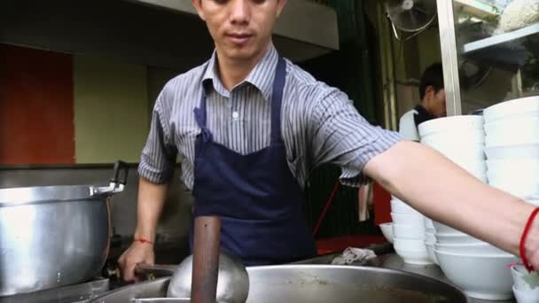 Man working as cook in Asian restaurant kitchen