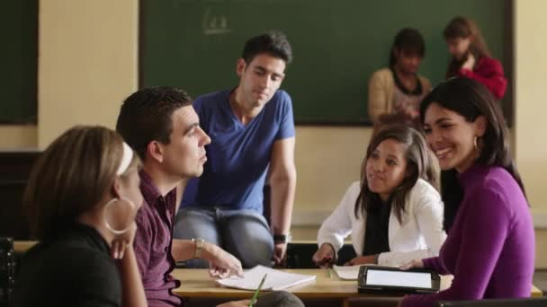 School, group of college students talking in classroom