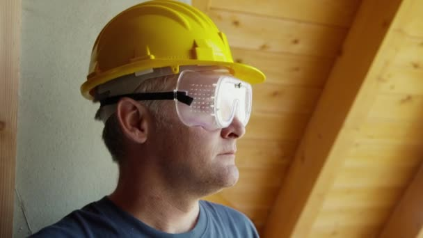 Manual worker taking off his glasses