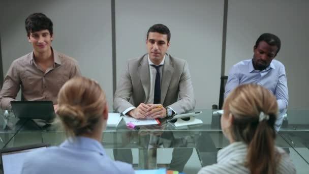Team of business people working in office meeting room