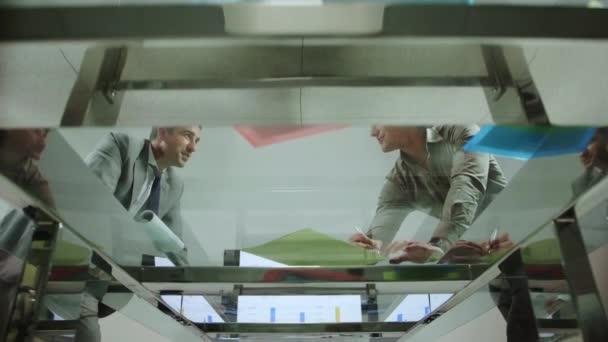 Business men shaking hands in office meeting room