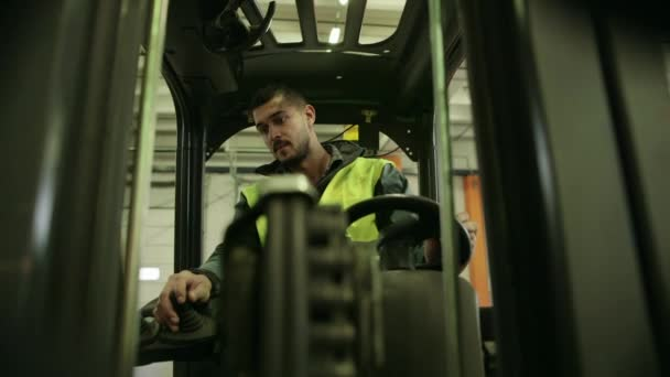 Manual worker operating fork lift to move boxes and parcels